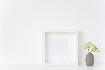 Minimal white square frame mock up with a Aegopodium in gray vase. Mockup for quote, promotion, headline, design. Template for small businesses, lifestyle bloggers, social media