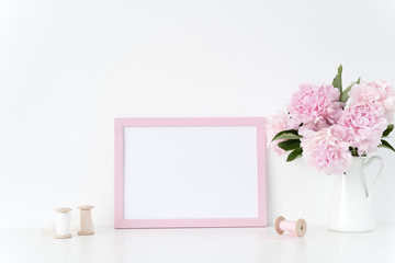 Pink landscape frame mock up with a pink peonies and silk ribbons beside the frame, overlay your quote, promotion, headline, or design, great for small businesses, lifestyle bloggers and social media