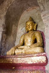 Buddha statue painted in gold and covered by golden paper