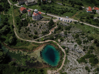 The spring of the Cetina River (izvor Cetine) in the foothills of the Dinara Mountain is named Blue Eye (Modro oko). Cristal clear waters emerge on the surface from a more than 100 meter-deep cave.