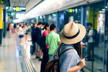 Tourist is using MTR train in Hong Kong for Transportation concept.