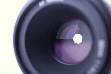 closeup camera shutter lens on white background.