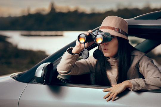 Female Detective Spying with Binocular from a Car