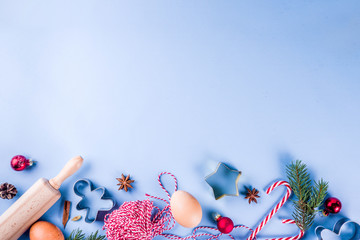 Christmas baking background with  Ingredients for cooking xmas baking, blue background, top view