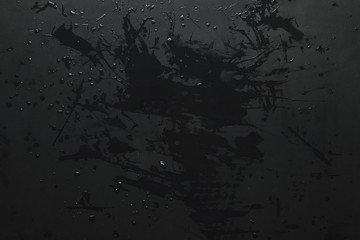 close-up view of empty black grunge background with water drops