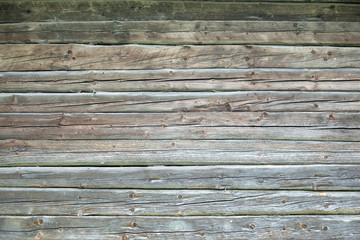 Grunge background of natural old hewn logs.