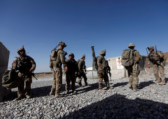 U.S. troops wait for their helicopter flight at an Afghan National Army (ANA) Base in Logar province, Afghanistan