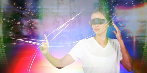 Composite image of young woman pointing while using virtual