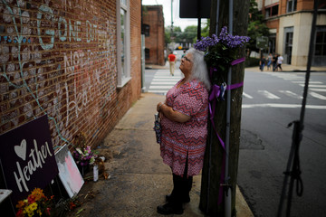 Susan Bro, mother of Heather Heyer, stands at the memorial at the site where her daughter was killed in Charlottesville