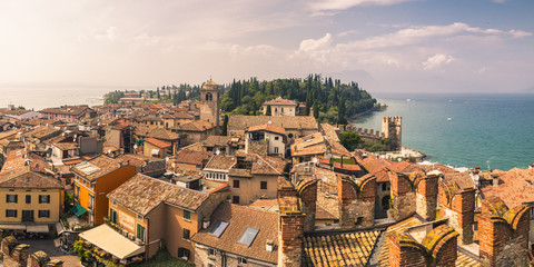 Scenic view of Sirmione town against cloudy sky