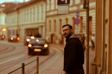 A retro style portrait of a handsome young hipster man in an urban environment.