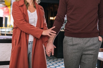Not let go. Close up of male and female hands touching each other