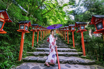 Wall Mural - Asian woman wearing japanese traditional kimono at  Kifune Shrine in Kyoto, Japan.