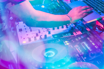 DJs are turntablism turntables plate mixer night party pub Motion blur wite light sunset abstract background. instagram style filter photo vintage tone