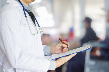 Health care, emergency room physician Writing a patient illness report.