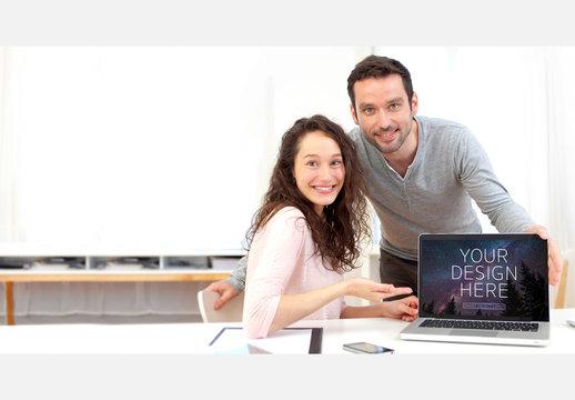Team Presenting a Laptop Mockup