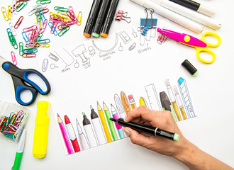 woman hand sketching a picture of stationery with a marker. White background with different stationery