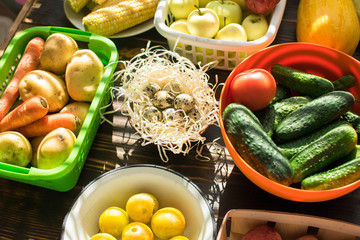 seasonal vegetables in August: potatoes, carrots, apples, zucchini, plums, peaches