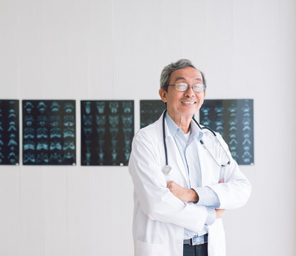 Portrait of a senior doctor on x-ray background.