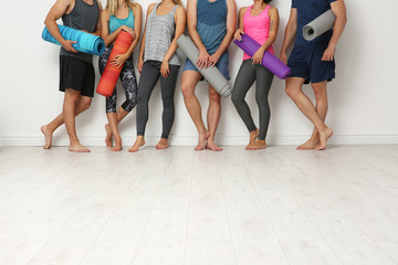 Keuken foto achterwand Fitness Group of young people waiting for yoga class
