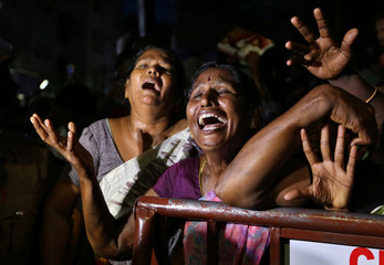 Supporters mourn outside the hospital after the demise of Indian Tamil leader M. Karunanidhi, in Chennai