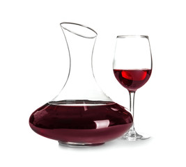 Elegant decanter and glass with red wine on white background