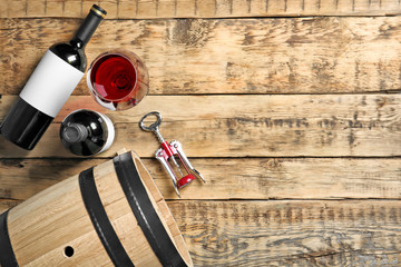 Glassware with red wine on wooden background, top view