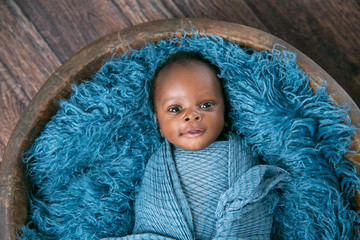 Newborn Baby Boy Swaddled in Blue