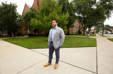 Democratic Governor candidate Abdul El-Sayed campaigns at Maples Elementary School on election day for the Michigan Primary Election in Dearborn