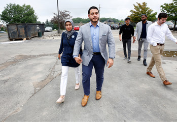Democratic Governor candidate Abdul El-Sayed arrives to vote with his wife Sarah Jukaku at Lakeside Assembly of God for the Michigan Primary Election in Shelby