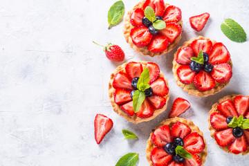 Wall Murals Dessert Strawberry tart on white. Summer dessert with berries
