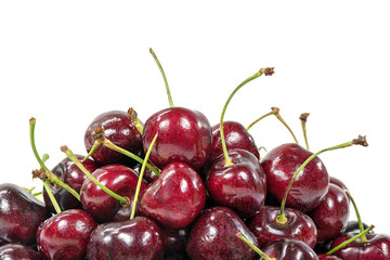 close up of ripe red cherries on white background