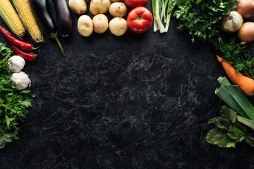 flat lay with food composition of autumn harvest on black marble surface