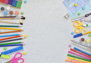 School accessories and supplies: pencils, markers, paint, pens, ruler on a light background. Back to school concept. Flat lay. Copy space