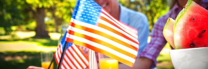 Cropped image of hand holding American flag