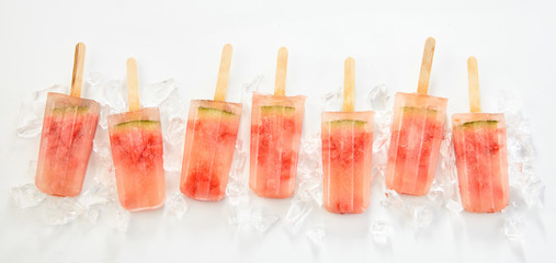 Line of frozen watermelon popsicles or lollies