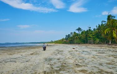 Bike ride on the beach, Ngwesaung, Myanmar