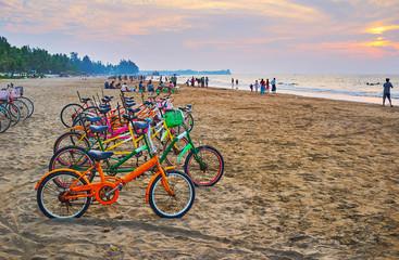Enjoy the bike ride on the beach, Chaung Tha, Myanmar