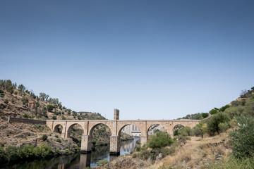 Roman bridge over the Tagus River in the city of Alcantara (Caceres, Spain)