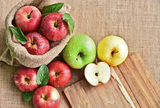 colorful of 3 Type of apple,Gala,Granny Smith,Golden Delicious with leaf in sack back and sack background.