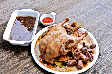 Homemade stewed duck with spice and dark soup with chili sauce.(Thai name is bpet-pa-loh). Thai duck menu.