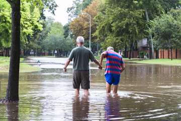Residents navigates hight flood waters