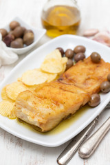 fried cod fish with olive oil on dish
