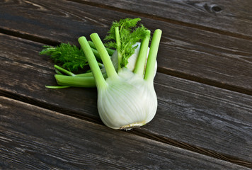 Fresh Florence fennel bulbs or Fennel bulb on wooden background..Healthy and benefits of Florence fennel bulbs.