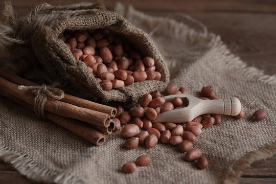 Peanuts seed in sackcloth bag on wooden table