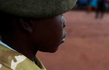 A former child soldier attends a child soldiers' release ceremony, outside Yambio