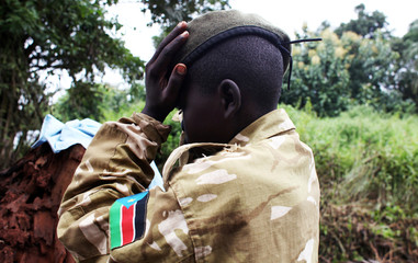 A former child soldier fixes his beret as he attends a child soldiers' release ceremony, outside Yambio