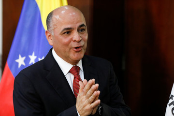 Venezuela's Oil Minister and President of PDVSA Manuel Quevedo gestures as he talks during a news conference in Caracas