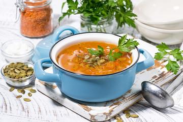 healthy lunch. spicy pumpkin soup in a saucepan