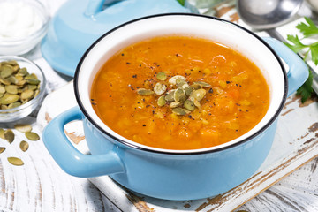 healthy lunch. spicy pumpkin soup with lentils in a saucepan, closeup